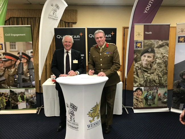 QuoStar Chairman John Knowles signing the Armed Forces Covenant
